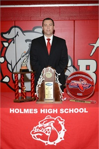 In addition to serving as assistant principal at Holmes High School in Covington, Ky., Booher is the school's head boys basketball coach.