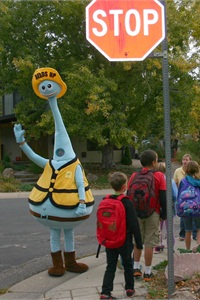 One component of Boulder's Transportation Options program is a street crossing awareness campaign called Heads Up. The Heads Up mascot is pictured here.