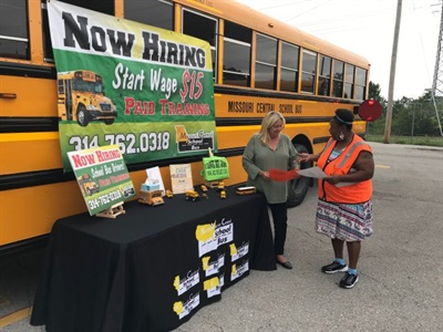 Scott Allen of North America Central School Bus says he focuses on driver recruitment as early as possible. One measure he takes is setting up a bus with a banner and a sign-up table in grocery store parking lots. Photo courtesy North America Central School Bus