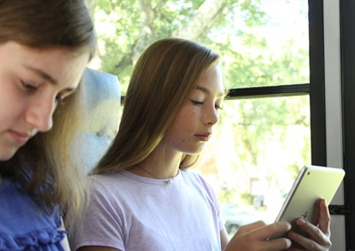 Aside from improved communication, delivering the Wi-Fi experience ultimately turns students' downtime on the bus into uptime. Photo courtesy Kajeet