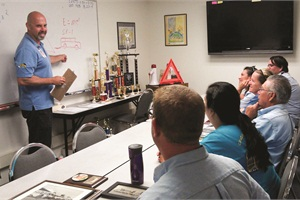 Pete Meslin, director of transportation for Newport-Mesa Unified School District in Costa Mesa, California, says he hires primarily for attitude and trains to build skills. Pictured is Victor Garza, driver instructor at Newport-Mesa,  conducting a training class for driver applicants.