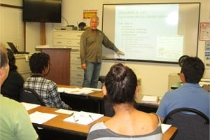When selecting a new driver, including a lead driver or driver trainer can help in conducting a more conversational-style interview. Pictured here: Don Smith, training supervisor at Orange Unified School District, conducts training for applicants,