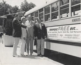 Clifford (left), his parents, Dorothy and James Clifford, and his brother-in-law Darrell Albers are seen here in 1973 with a bus that was being used to shuttle shoppers.