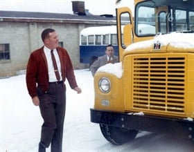 Clifford takes possession of a new 1964 Superior school bus on an International Harvester chassis.