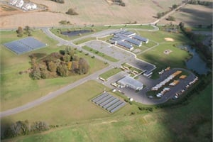 Medford Township Public Schools has solar roof and ground arrays at seven locations, including its transportation facility. Pictured is the district's Chairville Elementary School and the transportation center.