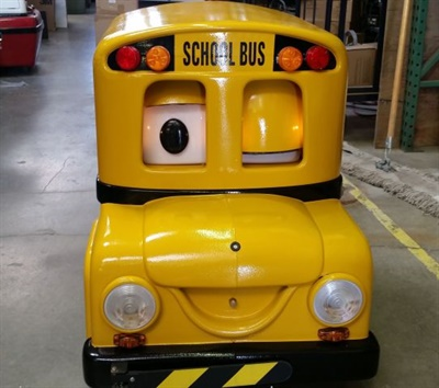 Robotronics' remote-controlled school bus robots, Buster and Barney, capture the attention of young students to teach them safety lessons. Shown here is Buster the School Bus, ready to roll into classrooms.
