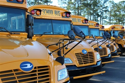 Roush CleanTech is hostinga California Road Show next month to demonstrate its near-zero emissions propane vehicles. File photo of Blue Bird Propane Vision school buses.