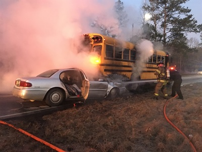 A bus from Darlington County (S.C.) School District was stopped at railroad tracks when a Buick struck the bus from behind and caught fire, spreading flames to the bus. Photo courtesy Palmetto Rural Fire Department and Medical Transport