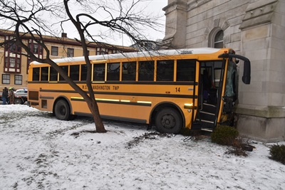 A bus from Metropolitan School District of Washington Township in Indiana collides with a tow truck then crashes into the side of a church. Photo courtesy Indianapolis Fire Department