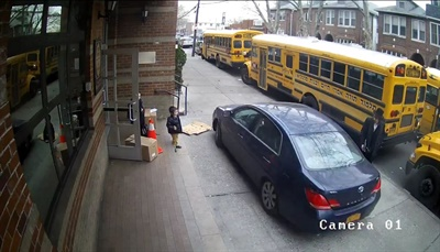 Video footage shows students in New York walkingacross the sidewalk when themotorist approaches and waits forthem to run in front of the vehicle before driving past them. Screenshot from video posted on Twitter by Dov Hikind
