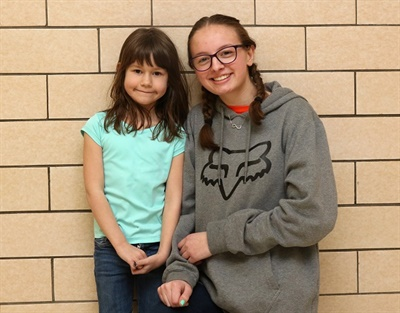 Rachel Trimbell (right) performed the Heimlich maneuver on first grader Danielle Miller to prevent her from choking on a piece of candy while she was on the school bus. Photo courtesy P.J. Harmer from Walton (N.Y.) Central School District