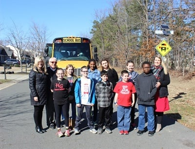 "The team of students from Holly Grove Middle School developed flashing signs to improve school bus stop safety, and became one of 50 state finalists for the Samsung ""Solve for Tomorrow"" contest. Photo courtesy Wake County (N.C.) Public School System"