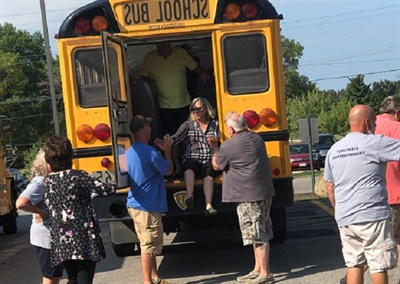 The district's bus drivers are required to complete several hands-on training programs, including a bus safety evacuation drill shown here. Photo courtesy Olentangy Local School District