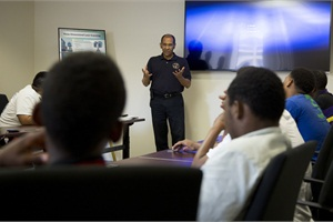 """Hart says that NTSB investigates crashes """"with an eye toward prevention, to keep it from happening again."""" He is pictured here talking with teens from the Aviation Career Education Summer Camp."""