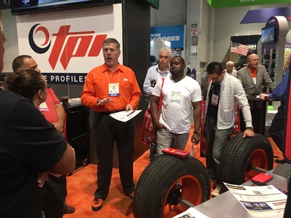 Tire Profiles President and Chief Operating Officer David Boyle drew a crowd while demonstrating the GrooveGlove at the 2017 SEMA Show.