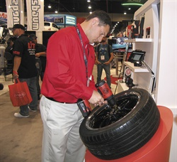 Jesse Della Valle demonstrates Chicago Pneumatic's CP8848K 1/2-inch cordless impact wrench. The kit includes two batteries and a charger.