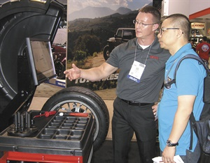 Alan Greene, sales representative for Hennessy, discusses a touchscreen interface that simplifies the balancing operation and other features of the Coats 1600-3D Direct Drive wheel balancer.
