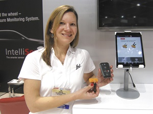 Tia Hoerig, program management analyst for Huf North America, holds the HC1000 wireless adapter.