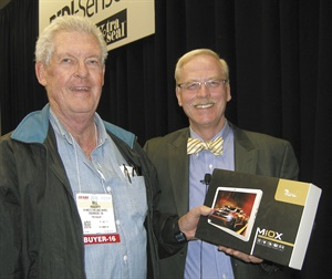 """Bill Hagerty (left), a former tire store owner from Escondido, Calif., who now offers tire forensics services, won a tablet following the """"Improving Sales and Profits"""" seminar led by Karl Stearns, president of KMS Marketing Solutions (right)."""