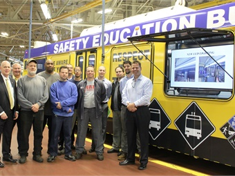 SEPTA GM Jeff Knueppel (far left), Assistant GM Ron Hopkins (second from left) and Assistant GM Jim Fox (far right) with the Berridge Shop staff that created the bus. Photo: SEPTA