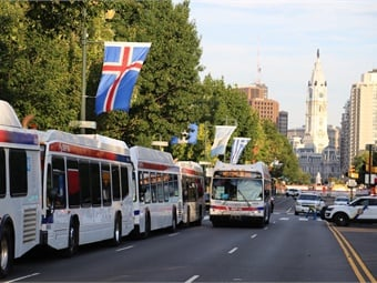 SEPTA buses staged on the Benjamin Franklin Parkway to transport delegates from events at the Philadelphia Museum of Art. Photo: SEPTA