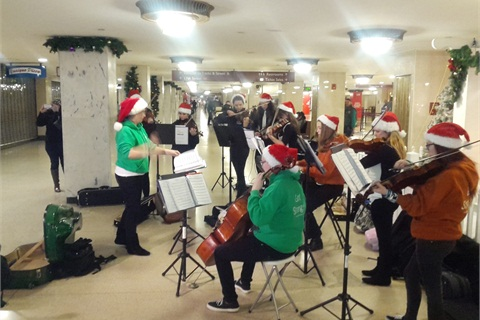 Got Strings student group performing at SEPTA's Suburban Station during the holiday season.