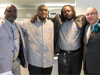 SEPTA employees Solomon Frazier, Richard Geist and Dana Barkley (with Chairman Deon far right) have used Project HOME's services to get their lives back on track. Solomon spoke at the Hub of Hope opening and is in the center of the ribbon cutting photo. Photo: Adam Dall