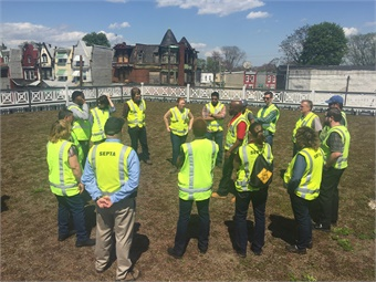 SEPTA employees on top of the green roof at the agency's 33rd and Dauphin Bus Loop. Photo: SEPTA