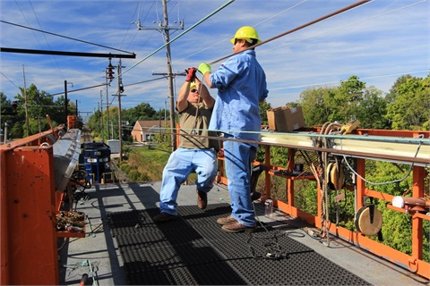 SETPA's wire train and crew at work. Photos courtesy: SEPTA