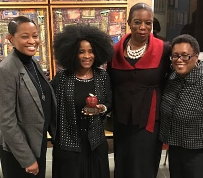 School bus driver Lurlean Hinton-Hodges, shown second from left, received the Milwaukee Superintendent's Award for Excellence in Education for starting a reading program on her bus.