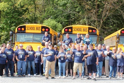 "STI's ""Bully-Free Buses"" campaign starts with Blue Shirt Day. Shown here are employees at STA Pine-Richland in Gibsonia, Pennsylvania, wearing blue shirts as a symbol of unity against bullying."