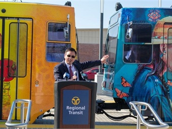 Henry Li, Sacramento RT GM/CEO at the unveiling of the agency's four new light rail trains, featuring local artists.