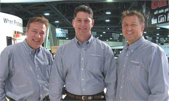 Regional Sales Managers Tony Febbo and Ward Hicken appear with VP, seated coach sales, Robert Goodnight. (L to R Febbo, Goodnight, Hicken)