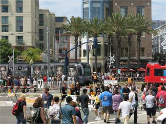 Riders entering and exiting Trolley at Gaslamp Quarter station.