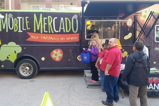 """During a health fair, San Antonio ISD transportation staff stepped aboard the """"Mobile Mercado,"""" a grocery store and demonstration kitchen on wheels."""