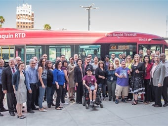 San Joaquin Regional Transit District employees and customers celebrate the August 2017 launch of the agency's electric bus route, the first 100% electric bus route in the U.S. Photo: SJRTD