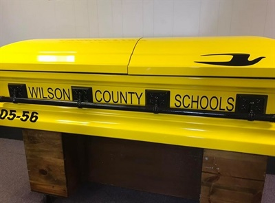 David Wright, a longtime driver with Wilson County (Tenn.) Schools, was laid to rest in a casket designed like a school bus after passing away on Aug. 13. Photo courtesy of Joe Stacey of Nashville Casket Sales