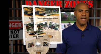 School Bus Safety Co. has updated its Danger Zones Training Program to re-emphasize the need for bus drivers to ensure that students are following proper crossing procedures. A screenshot from the video is shown here.