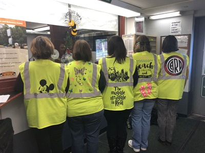 Eirene Farias, a bus driver for Brewster (N.Y.) Central School District, decorates safety vests for her coworkers. Shown here are some of her designs. Photo courtesy Brewster Central School District