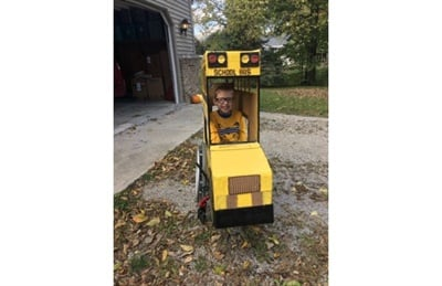 Gary Mompher created a cardboard Halloween costume to fit over 5-year-old Blake Mompher's wheelchair. It includes custom lettering and four red lights. Photo courtesy Megan Mompher