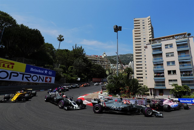 Romain Grosjean and Kevin Magnussen on the opening lap of the 2017 Monaco Grand Prix.