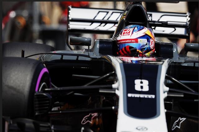 Romain Grosjean at speed in his VF-17.