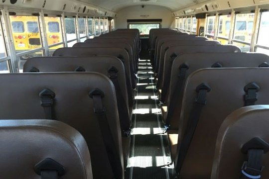 A PBS NewsHour piece looks at the safety benefits and financial concerns involved in the issue of seat belts on school buses.