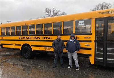 Seman-Tov Bus Co. in Neptune, N.J., is another small school bus company that may be in jeopardy without receiving funding for drivers and other staff during the pandemic-driven school closures. Shown left to right: Judah Nagar, fleet manager, and Kevin Dougherty, general manager. Photo courtesy Judah Nagar