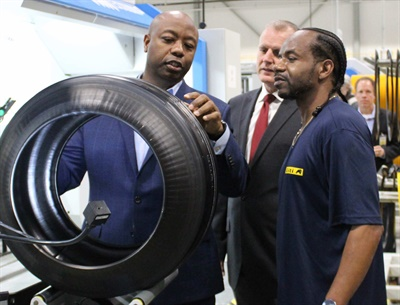 Se. Tim Scott, on left, talks with plant employees at the tire building section.