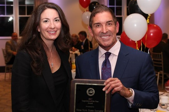 State Sen. Jeff Klein won the New York School Bus Contractors Association's Distinguished Service Award. He is seen here with association President Bree Allen.