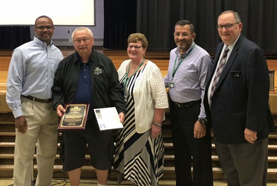 Shenendehowa's Gary Patenaude (second from left) was named School Bus Driver of the Year by the Cyr Foundation and the New York Association for Pupil Transportation.