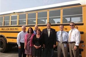 Rep. Seth Grove (center, in black suit) visited Pennsylvania contractor Red Lion Bus Inc. to see firsthand how school bus stop-arm cameras help to keep riders safe.