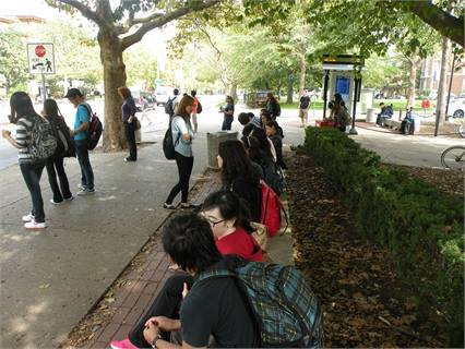 University of Illinois students wait to board at the Illini Union on Green Street. This stop is central to campus and MTD service.