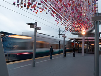 """Angle Lake Station features """"Cloud,"""" a sculpture consisting of hanging disks that can change appearance. Photo: ©2016 WSP 